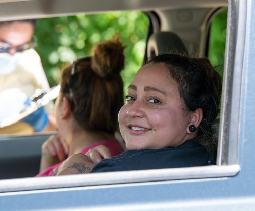 two women in car - REACH grantee